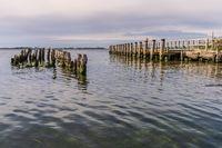 Groynes and the ferry pier near Ludwigsburg, Mecklenburg-Western Pomerania, Germany