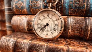 Vintage pocket watch. Vintage background Concept of time history.