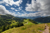 Trail by beautiful alpine country shank under blue