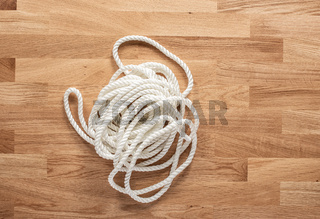White rope on a wooden table