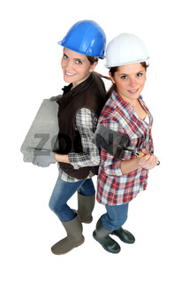 Two female bricklayers