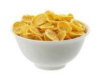 Bowl of corn flakes isolated on white background, top view