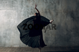 Ballerina. Young beautiful woman ballet dancer on stage.