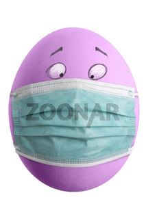 Large picture of an colored easter egg with drawn eyes and a corona mask.
