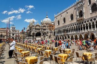 16. Jul 2012 - Street cafe waiting for tourist at St Mark square in Venice, Italy.