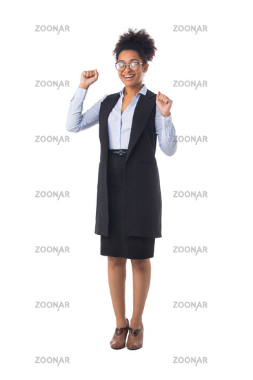 Business woman with arms raised