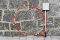 Broadband extension - fiber optic cable in front of the house wall