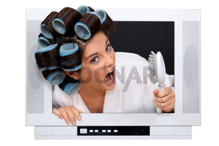 Woman in rollers inside a television