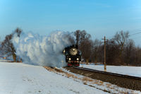 Vintage steam train puffing through countryside du