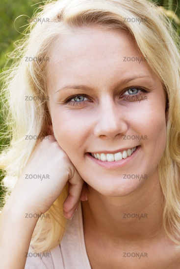 Happy young woman in summer