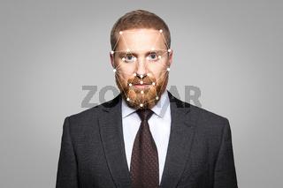 Biometric verification - businessman face recognition.