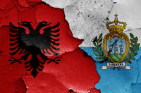 flags of Albania and San Marino painted on cracked wall