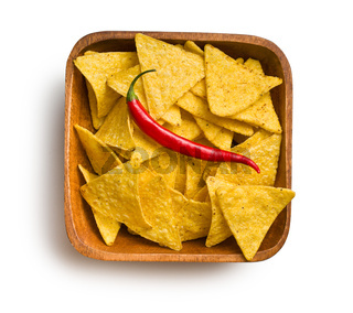 tortilla chips with red chili pepper in wooden background