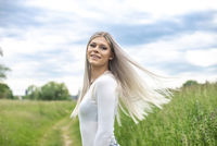 young beautiful woman with flying hairs