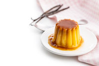 Sweet vanilla pudding. Sweet dessert with caramel topping.