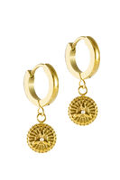 Golden earrings with protection symbol isolated on a white background.