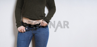 young woman with open jeans showing black lace panties underneath