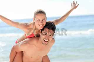 Beautiful man having girlfriend a piggyback