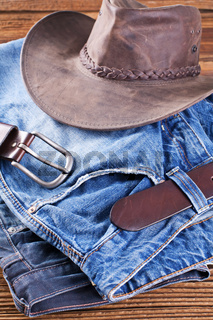 jeans and hat on a wooden board