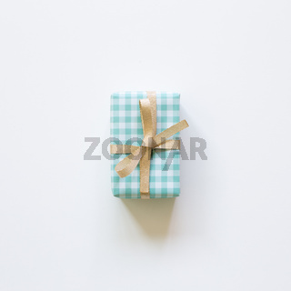 Green check pattern gift box isolated on white background. top view, copy space