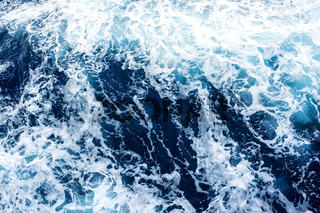 Sea Surface with Waves and Foam. View from above,