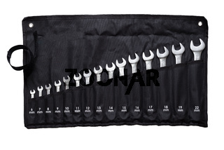 Set of combination wrenches in their special black sleeve.