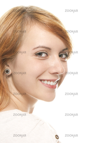 portrait of a smiling young redhead woman