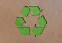 recycling symbol cut out of recycled paper