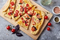 Puff pastry tart with cherry tomatoes, mozzarella and purple basil
