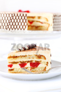 Delicious Tiramisu birthday cake with cherries