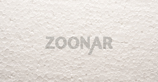 Texture of polystyrene board, close up as background, packing or insulation concept
