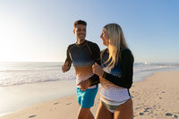 Caucasian couple enjoying time at the beach