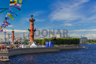 Saint-Petersburg, Russia - July 24, 2020: Rostral columns and the Neva River