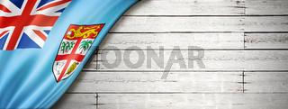 Fijian flag on old white wall banner
