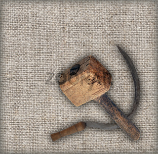 Old sickle and hammer on canvas