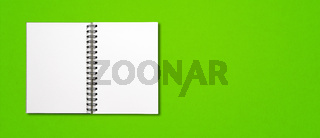 Blank open spiral notebook isolated on green banner