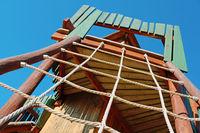 Children's playground with wooden climbing tower