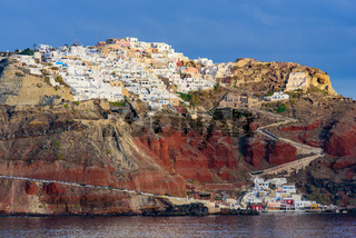 View of the white buildings of Oia village from Aegean Sea, Santorini, Greece