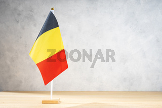 Belgium table flag on white textured wall. Copy space for text, designs or drawings