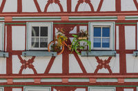 Facade of a historic half-timbered house in Meiningen with colorful bicylce for decoration