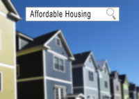 Internet search window with Affordable Housing text and homes in the background