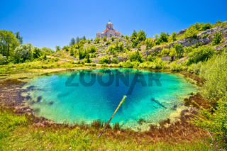 Cetina river source water hole and Orthodox church on the hill view