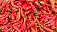 Top view on red pointed peppers displayed in food market