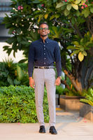 Full length shot of handsome African businessman outdoors at rooftop garden smiling