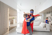 Father and son play superhero