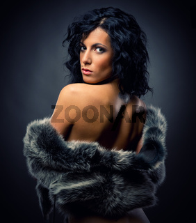 Beautiful sexy woman in fur coat