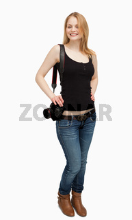 Cheerful woman holding a camera