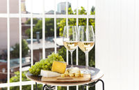 Wine with grapes and cheese on terrace