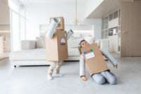 Children playing in robot at home