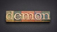 demon word abstract in vintage letterpress wood type